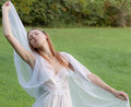 Outside in peignoir an image of a blissful woman a Royalty Free Stock Photo