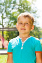 Outside portrait of little boy the caucasian happy in blue in the park Royalty Free Stock Images