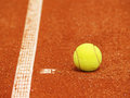 Outside tennis court line yellow tennis ball Royalty Free Stock Photo