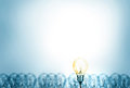 Outstanding creative idea background concept . one Light bulb glowing among a group light bulbs. Royalty Free Stock Photo