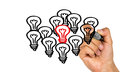 Outstanding idea concept light bulbs hand drawing on whiteboard Royalty Free Stock Photos