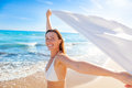 Outstretched carefree sea girl with tissue Royalty Free Stock Photography