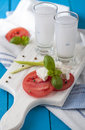 Ouzo fresh tomatoes and cheese with Royalty Free Stock Photography