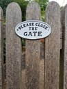Please close the gate sign. Royalty Free Stock Photo