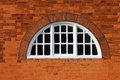 Oval window on a modern red brick building Royalty Free Stock Images
