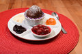 Oven baked chocolate cupcake with fruit jam Royalty Free Stock Image