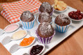 Oven baked chocolate muffins with fruit jam Royalty Free Stock Images