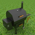 Oven barbecue grill on the green grass Stock Photo