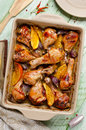 Oven roasted orange chicken with red onion honey legs Royalty Free Stock Photography