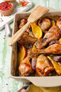 Oven roasted orange chicken with red onion honey legs Stock Images