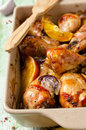 Oven roasted orange chicken with red onion honey legs Stock Photos