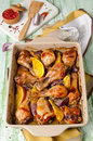 Oven roasted orange chicken with red onion honey legs Royalty Free Stock Photo