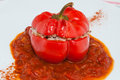Oven tomato stuffed with mince meat close up on a single on a white dish Stock Image