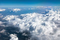 Over the clouds takene while flying in a plane Royalty Free Stock Image