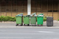 Over filled Wheelie bins, waste containers full of trash on foot Royalty Free Stock Photo