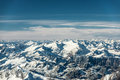 Over the mountain peaks covered with snow at winter Royalty Free Stock Photo