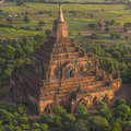 Over the temples of bagan archaeological zone in in early morning sunlight myanmar burma pagoda in Stock Photos