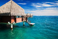 Over water bungalow with steps into clear ocean Royalty Free Stock Image