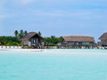 Over water bungalows at maldives beautiful beach with Stock Image