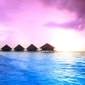 Over water bungalows with steps into amazing green lagoon Stock Photo