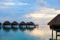 Over water villas at sunset in french polynesia Royalty Free Stock Photography