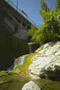 Over the weir trickle water flowing a damn in an italian river piacenza italy Stock Photography
