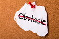 Overcome the obstacle concept on cork noticeboard Royalty Free Stock Photography