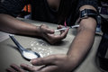 Overdose asian female drug addict hand drugs narcotic syringe i in action Stock Photo