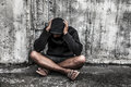 Overdose asian male drug addict with problems man in hood with hands on his head Stock Images