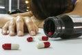 Overdose woman drug addict hand drugs narcotic syringe on floor white background Royalty Free Stock Image