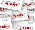 Overdue bills pile envelopes late payment penalty fees word in to illustrate that are in and creditors hitting you with penalties Royalty Free Stock Image