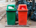 Overfilled trash of large bins for rubbish recycling and garden waste Stock Image