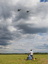 Overflight of military aircraft moscow region june people watch flight at the international technical forum army at the airfield Royalty Free Stock Photography