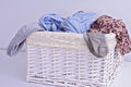 Overflowing laundry basket. Household chore concept Royalty Free Stock Photo