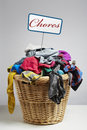 Overflowing laundry basket household chore concept on white background Royalty Free Stock Image