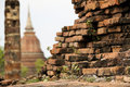 Overgrown old brick wall sukhothai temple ruins Stock Photo