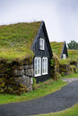 Overgrown typical rural icelandic house at overcast day houses misty Royalty Free Stock Photos