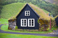 Overgrown typical rural icelandic house at overcast day houses misty Stock Photo