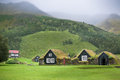 Overgrown typical rural icelandic houses at overcast misty day Royalty Free Stock Photography