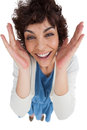 Overhead of amazed woman with hands wide opened on white background Royalty Free Stock Photography