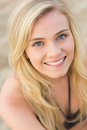 Overhead close up portrait of smiling blond at beach a relaxed young the Royalty Free Stock Photos