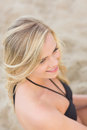 Overhead close up of a smiling relaxed blond at beach young the Stock Photos