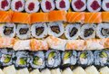 Overhead japanese sushi food. Maki ands rolls with tuna, salmon, shrimp, crab and avocado. Top view of assorted sushi, all you can Royalty Free Stock Photo
