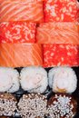 Overhead japanese sushi food. Rolls with tuna, salmon, shrimp, crab and avocado. Top view of assorted sushi, all you can eat menu Royalty Free Stock Photo