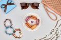 Overhead outfit fashion essentials set macarons clothes french dessert accessories glamor creative handbag clutch sunglasses gift Royalty Free Stock Image