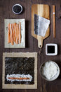 Overhead shot of ingredients for preparing sushi on wooden table Royalty Free Stock Photo