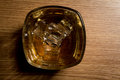 Overhead shot of whiskey glass with ice cubes Stock Photos