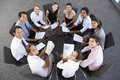 Overhead View Of Businesspeople Seated In Circle At Company Seminar Royalty Free Stock Photo