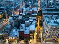 Overhead view of the busy streets of Nolita and SoHo neighborhoods with colorful night lights shining at dusk in New York City Royalty Free Stock Photo