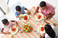 Overhead view of family eating meal together pasta Royalty Free Stock Images